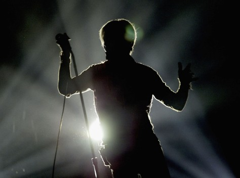 MANCHESTER, ENGLAND - NOVEMBER 17: David Bowie in silhouette performs on the first night of his UK tour at the MEN Arena on November 17, 2003 in Manchester, England. (Photo by Alex Livesey/Getty Images)